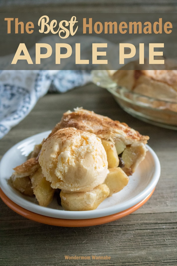 a slice of apple pie topped with a scoop of vanilla ice cream on a white and orange plate on a wood table with the rest of the pie and a linen in the background with title text reading The Best Homemade Apple Pie