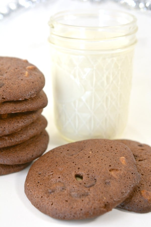 chocolate cookies next to a glass of milk