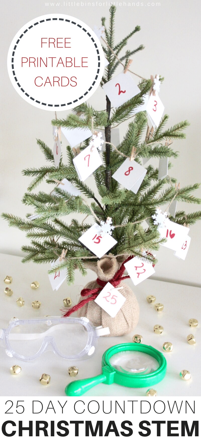 a Christmas tree with numbered cards on it on a white table with gold beads, goggles, and a magnifying glass on it with title text reading 25 Day Countdown Christmas Stem