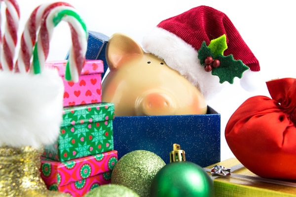 a pig wearing a Christmas hat in a box surrounded by presents