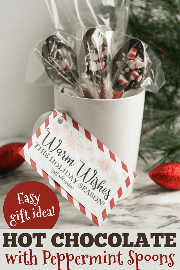 This DIY Hot Chocolate Gift idea is an easy and inexpensive gift that's perfect for almost everyone! Homemade cocoa mix with peppermint stirring spoons packaged in a mug. Free printable gift tag included! #giftideas #Christmas