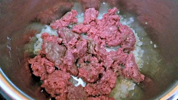 ground beef cooking in an instant pot