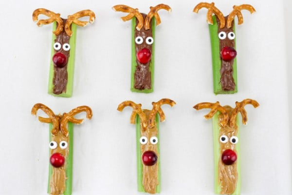celery stuffed with peanut butter or nutella made to look like reindeer with pretzels as antlers, candy eyes, and cranberries for a nose
