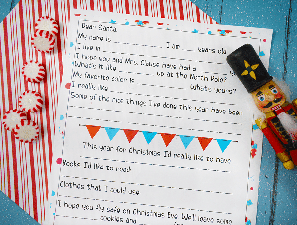 printable Santa letter on a red, white and blue background next to some red and white candies and a wooden nutcracker
