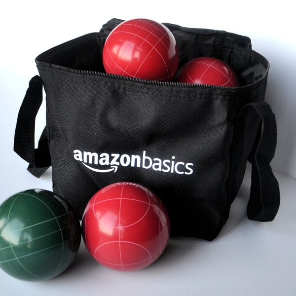 an amazon basics black bag with bocce balls in it and next to it