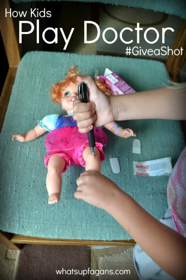a child pretending to give a shot to a doll on a chair with a green cushion on it with title text reading How Kids Play Doctor #Giveashot