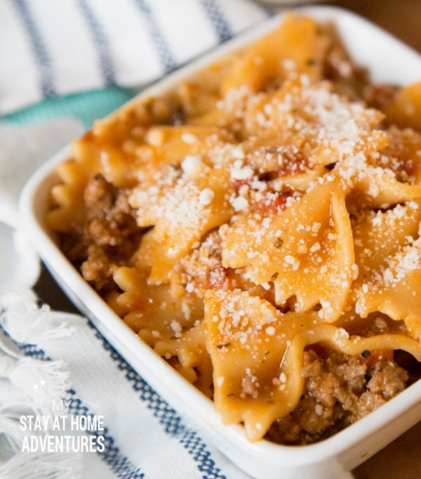 beef and pasta in a white bowl
