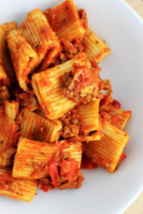 sausage rigatoni pasta on a white plate