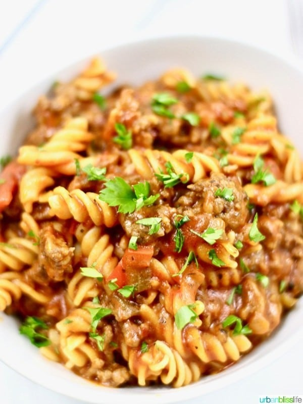sausage and peppers pasta in a white bowl