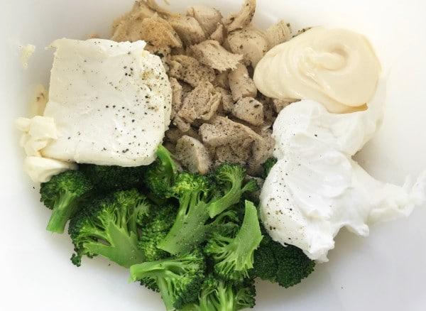 chicken, broccoli, cream cheese, mayonnaise, sour cream, onion powder, garlic powder, and a little salt and pepper in a white bowl