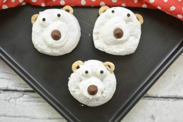 Polar Bear Donuts on a cookie sheet with a red and white polka dot cloth in the background