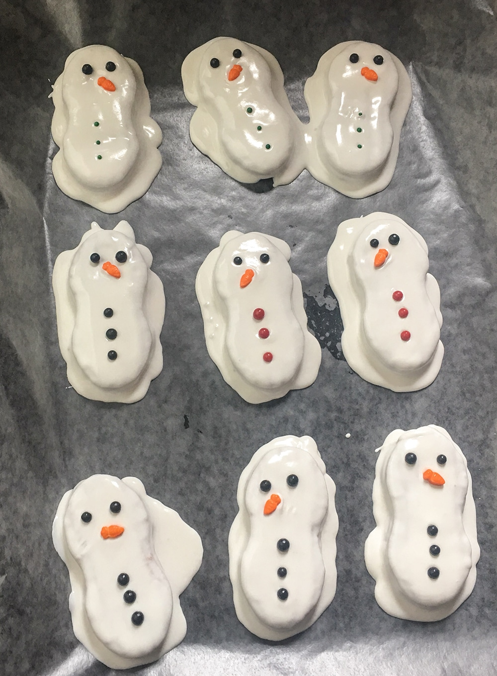 Add eyes, nose, and buttons to snowman nutter butter cookies