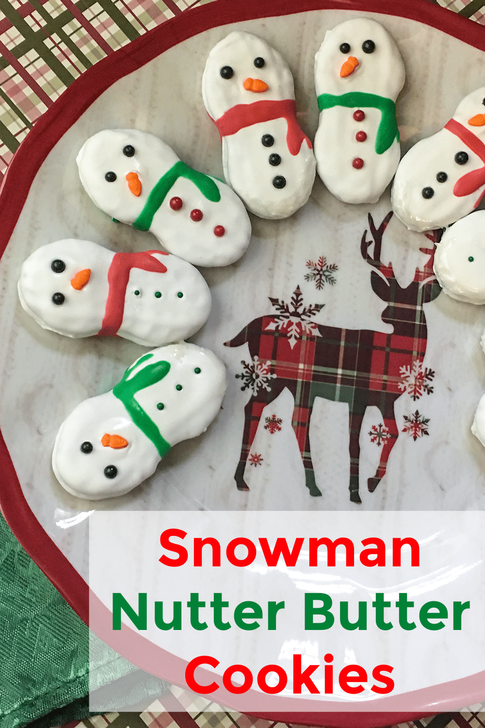 nutter butter cookies decorated to look like a snowman on a reindeer plate with title text reading Snowman Nutter Butter Cookies