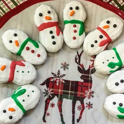 Snowman nutter butter cookies arranged on a plate