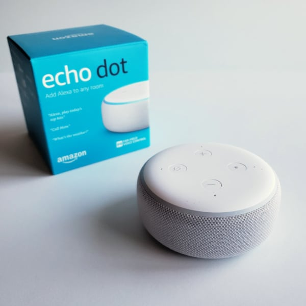an amazon echo dot and it's box on a white background