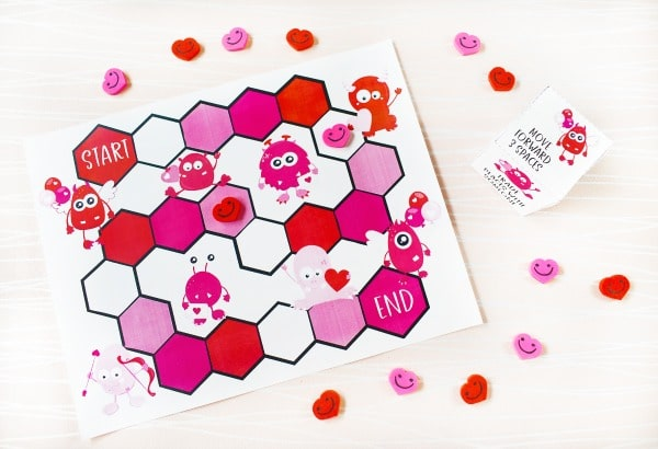 free Printable Valentine Game on a white table with hearts around it