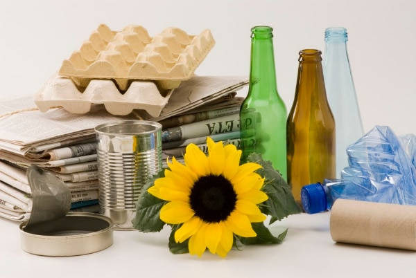 various recyclable household items, like cans, newspapers and bottles