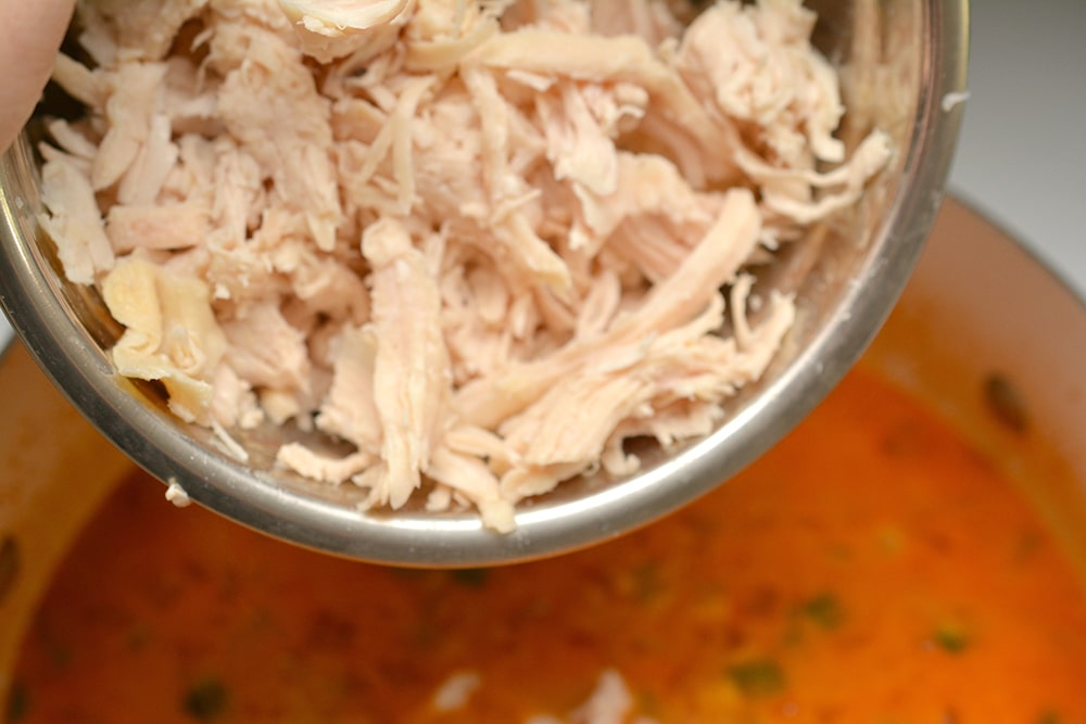Add chicken to keto chicken enchilada soup