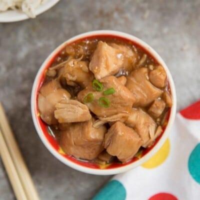 Instant Pot Orange Chicken with chopsticks and polka dot napkin