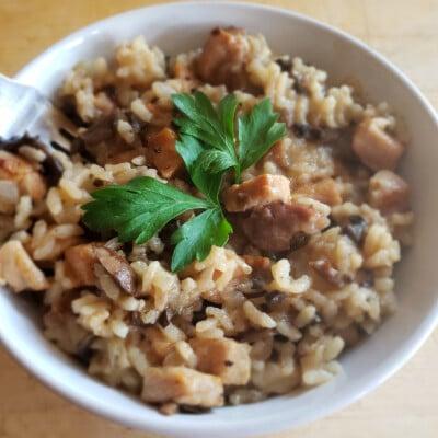 Pressure Cooker Pork Risotto in a while bowl