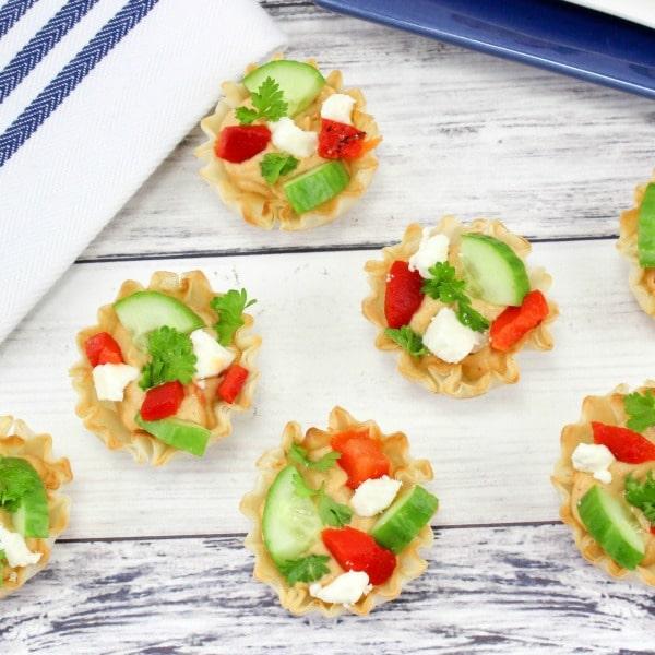 Roasted Red Pepper Hummus Phyllo Cup Appetizers on a table