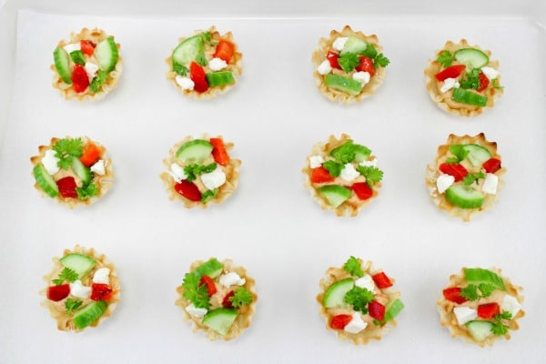 Roasted Red Pepper Hummus Phyllo Cup Appetizers on white parchment paper