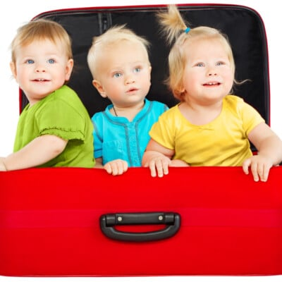 toddlers hanging out in a suitcase
