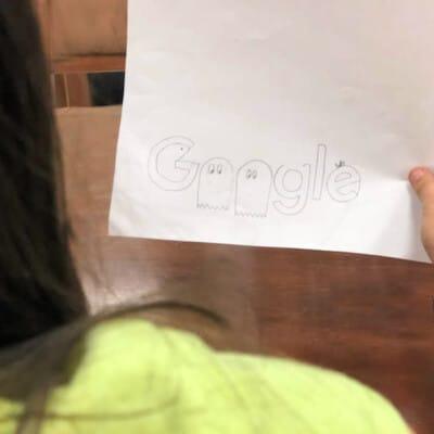 girl showing off her Google Doodle skills