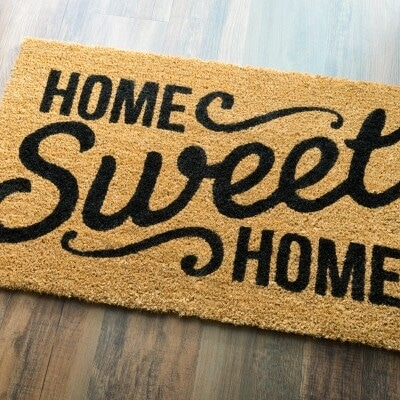 close up of front door mat reading home sweet home