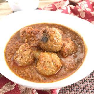 Instant Pot Mozzarella Stuffed Meatballs in a white serving bowl