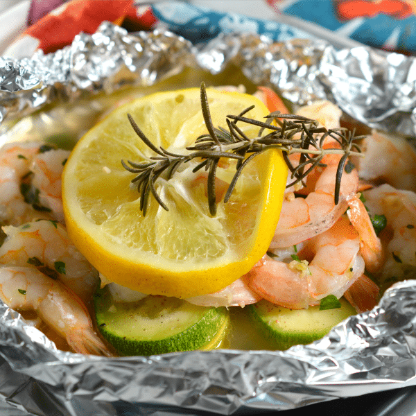 Keto Shrimp Foil Packets topped with a slice of lemon