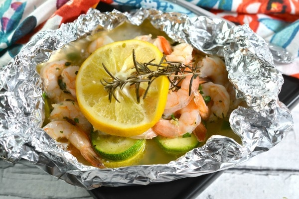 Keto Shrimp Foil Packets topped with a lemon slice