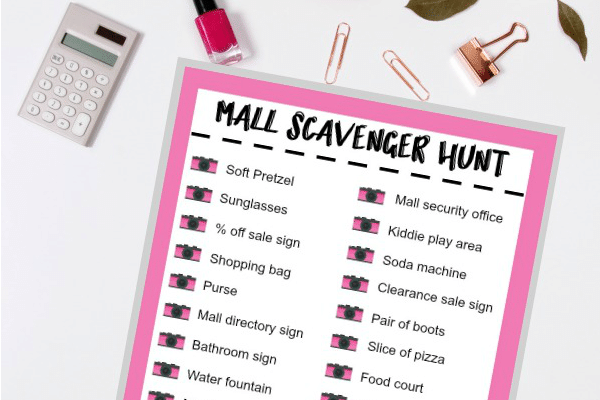 printable Mall Scavenger Hunt list on a white table next to a calculator, nail polish, paper clips