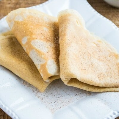 close up of Snickerdoodle Crepes on a square white plate