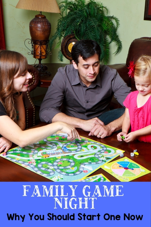 a mom, dad and little girl sitting around a table playing a board game with title text at the bottom reading Family Game Night Why You Should Start One Now