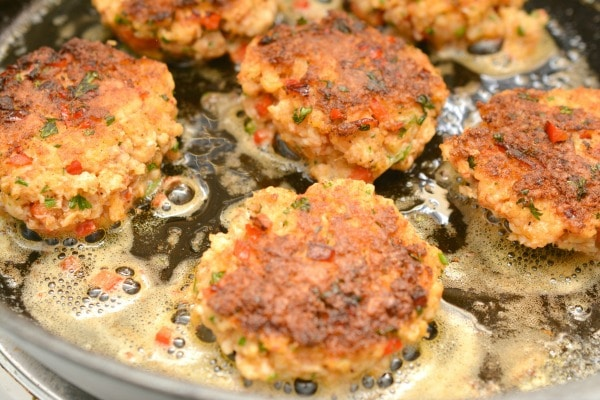 Keto Lobster Cakes cooking in a skillet
