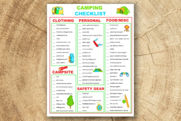 free camping checklist printable on a wood background