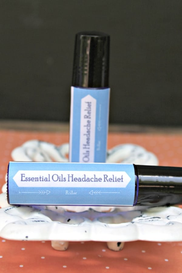 two essential oil headache relief rollers on a decorative plate