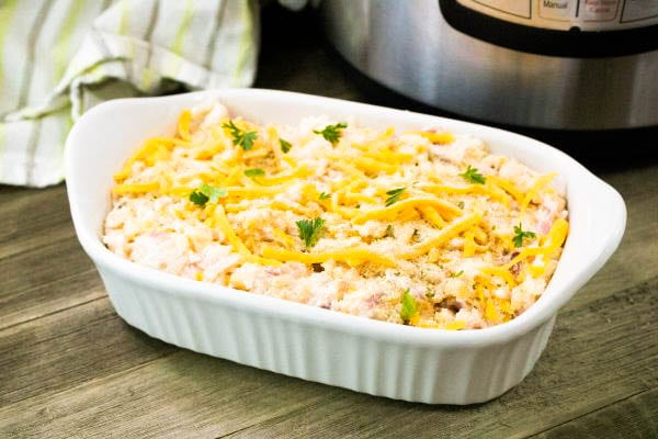 Instant Pot Cheesy Potatoes in casserole dish