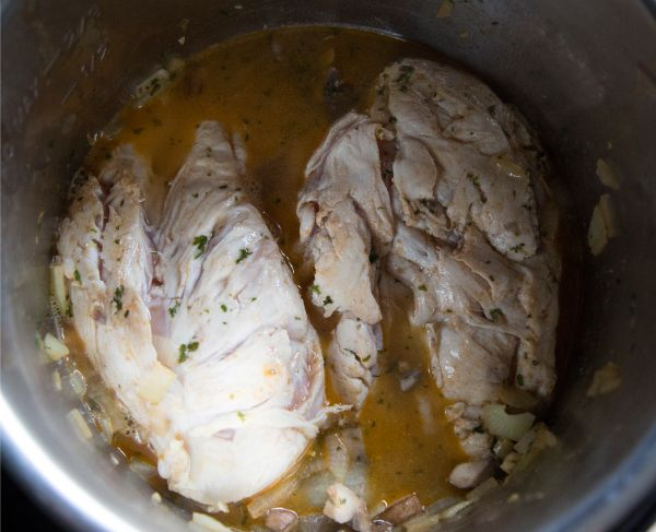 chicken and liquid in an instant pot