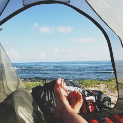 camping and laying down in tent