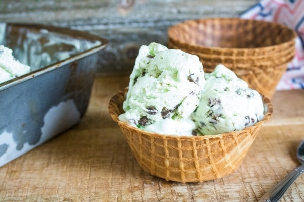 homemade mint chip ice cream recipe in a waffle bowl with extra bowls