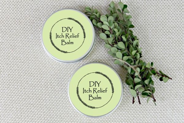 essential oil itch relief cream in containers labelled DIY Itch Relief Balm