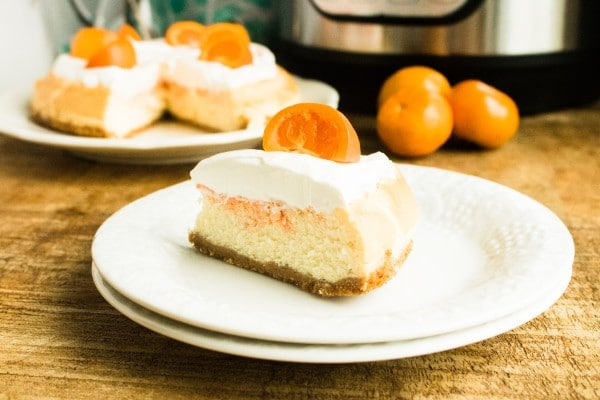 Instant Pot Orange Cream Cheesecake slice on a plate