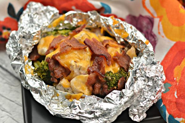 chicken bacon ranch foil packets on a baking sheet