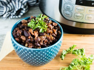 Instant Pot Pork and Beans in blue bowl