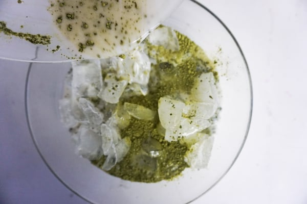 machta milk mixture being poured into bowl of ice