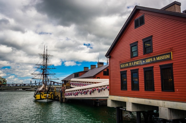 the Boston Tea Party Museum on the water with a boat in the background