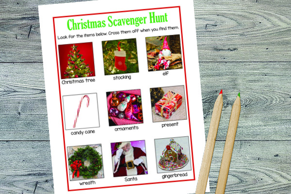 printable christmas scavenger hunt next to pencils on a wood background