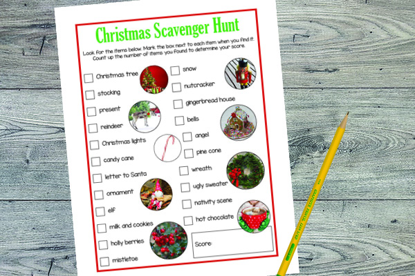 printable Christmas Scavenger Hunt next to a pencil on a wood table